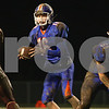 Kyle Bursaw – kbursaw@shawmedia.com<br /> <br /> Genoa-Kingston quarterback Griffin McNeal looks for a receiver in the second quarter of the game against Marengo at Genoa-Kingston High School on Friday, Oct. 19, 2012.