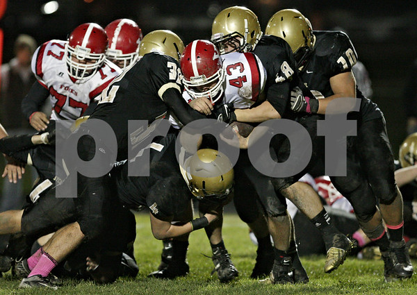 Rob Winner – rwinner@shawmedia.com<br /> <br /> Yorkville running back Anton Jones (43) is tackled by a group of Sycamore defenders for a short gain during the second quarter in Sycamore Friday, Oct. 19, 2012.