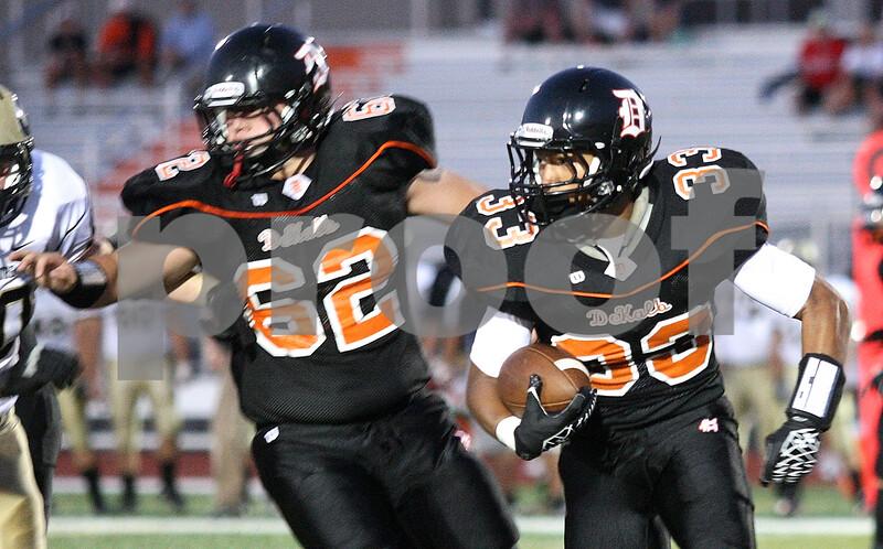 Kyle Bursaw - kbursaw@shawmedia.com<br /> <br /> DeKalb's Dre Brown (33) looks for a lane as Wes Leffelmann (62) blocks in the first quarter of the game against Galesburg at DeKalb High School on Friday, Aug. 24, 2012.