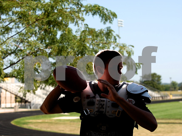 Kyle Bursaw - kbursaw@shawmedia.com<br /> <br /> TAB COVER<br /> Quarterback Devin Mottet at Sycamore High School on Friday, Aug. 3, 2012.