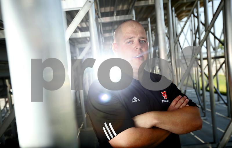 Kyle Bursaw - kbursaw@shawmedia.com<br /> <br /> Todd Hallaron will lead the Barbs on the gridiron this fall as the new head coach.<br /> <br /> Taken at DeKalb High School on Friday, Aug. 3, 2012.