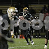Rob Winner – rwinner@shawmedia.com<br /> <br /> Sycamore quarterback Devin Mottet (15) looks to pass during the second quarter in a Class 5A playoff game in Sycamore Saturday, Oct. 27, 2012. Sycamore defeated Chicago King, 35-13.