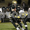 Rob Winner – rwinner@shawmedia.com<br /> <br /> Sycamore running back Austin Culton (1) carries the ball during the third quarter in a Class 5A playoff game in Sycamore Saturday, Oct. 27, 2012. Sycamore defeated Chicago King, 35-13.