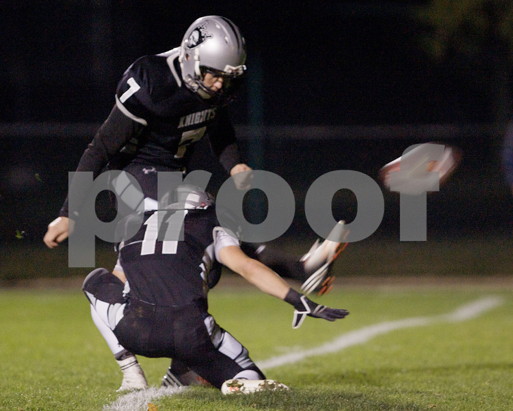 Karen Naess For The Chronicle<br /> <br /> Kaneland's Matt Rodriguez makes the feild goal attempt against Belvidere in playoff play on Saturday at Kaneland.