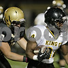 Rob Winner – rwinner@shawmedia.com<br /> <br /> Sycamore defensive lineman Jacob Davis (10) tackles Chicago King running back Kyle Harris (34) for a 6-yard loss during the third quarter in a Class 5A playoff game in Sycamore Saturday, Oct. 27, 2012. Sycamore defeated Chicago King, 35-13.