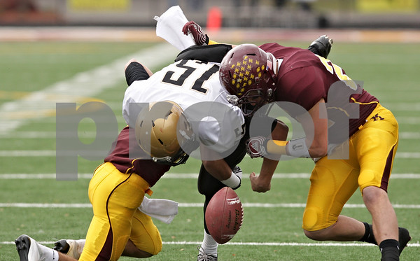 Rob Winner – rwinner@shawmedia.com<br /> <br /> Sycamore quarterback Devin Mottet (15) fumbles the ball in the first quarter of a Class 5A playoff game in Lombard, Ill., Saturday, Nov. 3, 2012. Montini defeated Sycamore, 24-22.