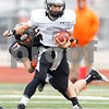 Sean King for the Chronicle<br /> <br /> Kaneland's Drew David (4) carries the ball and breaks the tackle from Lincoln-Way West's Zach Speaker (17) during a Class 5A playoff game in New Lenox, Ill., on Saturday, Nov. 3, 2012. Lincoln-Way West defeated Kaneland, 31-15.