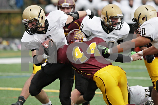 Rob Winner – rwinner@shawmedia.com<br /> <br /> Sycamore running back Austin Culton carries the ball in the second quarter of a Class 5A playoff game in Lombard, Ill., Saturday, Nov. 3, 2012. Montini defeated Sycamore, 24-22.