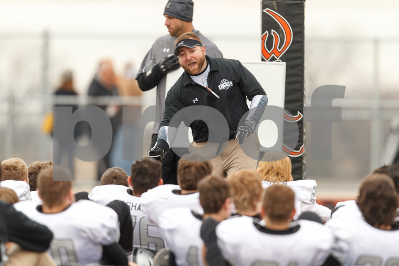 Sean King for the Chronicle<br /> <br /> Kaneland's assistant coach Keith Snyder instructs his team during half time during a Class 5A playoff game in New Lenox, Ill., on Saturday, Nov. 3, 2012. Lincoln-Way West defeated Kaneland, 31-15.