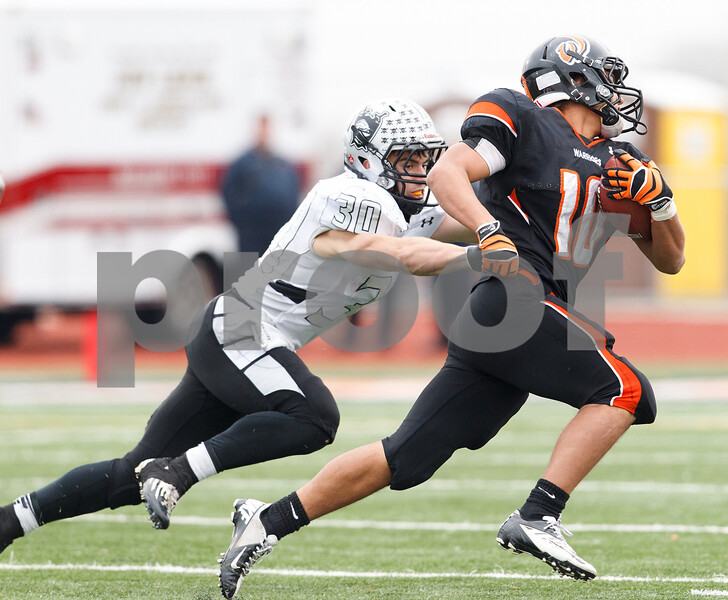 Sean King for the Chronicle<br /> <br /> Kaneland's Jesse Balluff (30) tackles Lincoln-Way West's Javier Montalvo (10) in the backfield for a loss during a Class 5A playoff game in New Lenox, Ill., on Saturday, Nov. 3, 2012. Lincoln-Way West defeated Kaneland, 31-15.