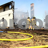Kyle Bursaw – kbursaw@shawmedia.com<br /> <br /> Leland firefighters (from left) Fred Seville, Jim Barnes and Tim Nelson work to extinguish what's left of a building at 3159 Graham Rd in Somonauk, Ill. on Wednesday, March 28, 2012. Homeowner Michael Hamer said he has been grilling out about an hour before his meeting, and said that possibly is where the fire started.