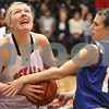 Rob Winner – rwinner@shawmedia.com<br /> <br /> DeKalb center Maddy Johnson is fouled by Central's Catherine Kaynish during their game in DeKalb, Ill., on Tuesday, Dec. 6, 2011.