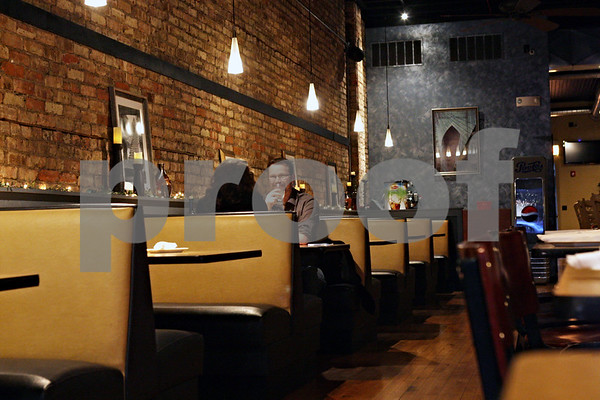 Rob Winner – rwinner@shawmedia.com<br /> <br /> Jenna Hansen and Clint Bailey finish up their meal at Tapa La Luna in DeKalb on Thursday evening. Tapa La Luna has re-opened under new ownership.