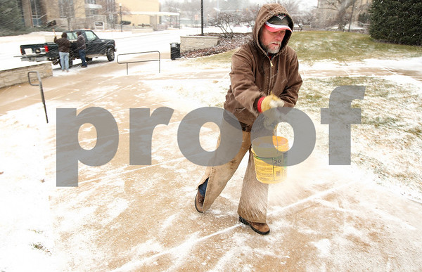Kyle Bursaw – kbursaw@shawmedia.com<br /> <br /> Guy Bays, with the NIU Grounds department, lays down some salt after shoveling the sidewalks outside Williston Hall on Thursday, Jan. 12, 2012.
