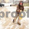 Kyle Bursaw – kbursaw@shawmedia.com<br /> <br /> Guy Bays, with the NIU Grounds department, lays down some salt after shoveling the sidewalks outside Williston Hall on Thursday, Jan. 12, 2012.