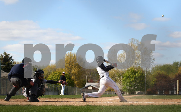 Kyle Bursaw – kbursaw@shawmedia.com<br /> <br /> DeKalb's Trenton Sopko sends a ball flying during the first inning against Sycamore at Huntley Middle School on Tuesday, April 10, 2012.