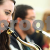 "Kyle Bursaw – kbursaw@shawmedia.com<br /> <br /> DeKalb Sophomore Nelle Conley plays saxaphone with the DeKalb High School Jazz Ensemble in the band room on Monday, March 12, 2012. The group will be competing in the 17th annual ""Essentially Ellington"" competition."