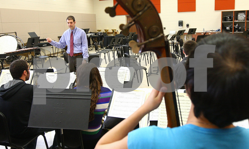 """Kyle Bursaw – kbursaw@shawmedia.com<br /> <br /> Steve Lundin directs the DeKalb High School Jazz Ensemble in the band room on Monday, March 12, 2012. The group will be competing in the 17th annual """"Essentially Ellington"""" competition."""