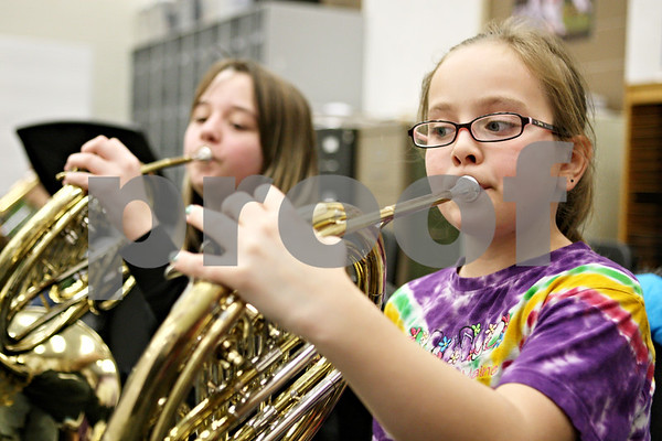 Rob Winner – rwinner@shawmedia.com<br /> <br /> Fifth grade students including Kaylee DuMont (front) and Briana Foster play the french horn during band practice at Sycamore Middle School on Tuesday.