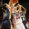 Rob Winner – rwinner@shawmedia.com<br /> <br /> Toledo's Courtney Ingersoll (2) fouls Northern Illinois' Courtney Shelton (21) during the second half in DeKalb on Saturday afternoon. Toledo defeated NIU, 49-47.