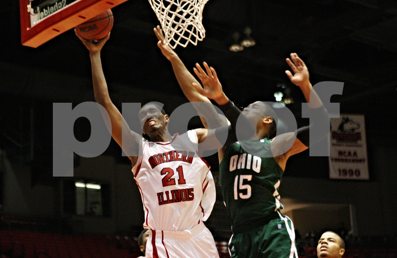 Rob Winner – rwinner@shawmedia.com<br /> <br /> Northern Illinois forward Keith Gray (21) is fouled by Ohio guard Nick Kellogg during the first half in DeKalb on Wednesday, Feb. 1, 2012.