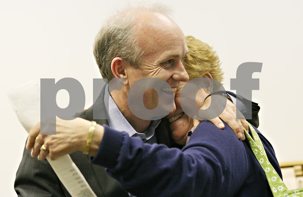 Rob Winner – rwinner@shawmedia.com<br /> <br /> Clay Campbell (left) is hugged by Joan Stanley, of Waterman, after his speech where he thanked his supporters after winning the Republican nomination for DeKalb County State's Attorney on Tuesday night at the State Street law offices of Christine Taylor, Jill Konen and Mary Petruchius in Sycamore.