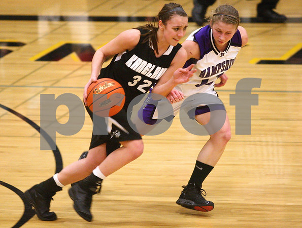 Kyle Bursaw – kbursaw@shawmedia.com<br /> <br /> Kaneland forward Emma Bradford takes the ball up the court with Hampshire's Michelle Dumoulin defending during the first quarter at Sycamore High School on Monday, February 20, 2012.