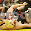 Rob Winner – rwinner@shawmedia.com<br /> <br /> Sycamore's Austin Culton (left) controls Rock Island's Kyle Kerres during their 152-pound match in a Class 2A Sycamore Team Sectional semifinal on Tuesday, Feb. 21, 2012.