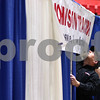 Kyle Bursaw – kbursaw@shawmedia.com<br /> <br /> Jason Pennycook (front) and Jared Hitchins adjust the sign for Johnson Tractors, while setting up their display in the Convocation Center for the annual farm show on Tuesday, Jan. 10, 2012
