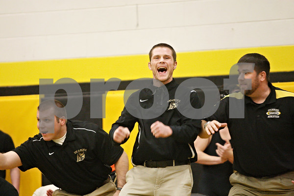 Rob Winner – rwinner@shawmedia.com<br /> <br /> Sycamore coach Alex Nelson celebrates his team's victory over Rock Island in a Class 2A Sycamore Team Sectional semifinal on Tuesday, Feb. 21, 2012.