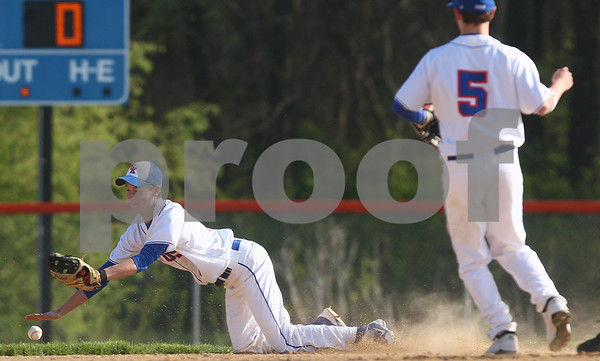 Kyle Bursaw – kbursaw@shawmedia.com<br /> <br /> Genoa-Kingston's Jake Langford dives but is unable to come up with the ball in the first inning of the Cogs game against Winnebago in Genoa, Ill. on Monday, April 2, 2012.