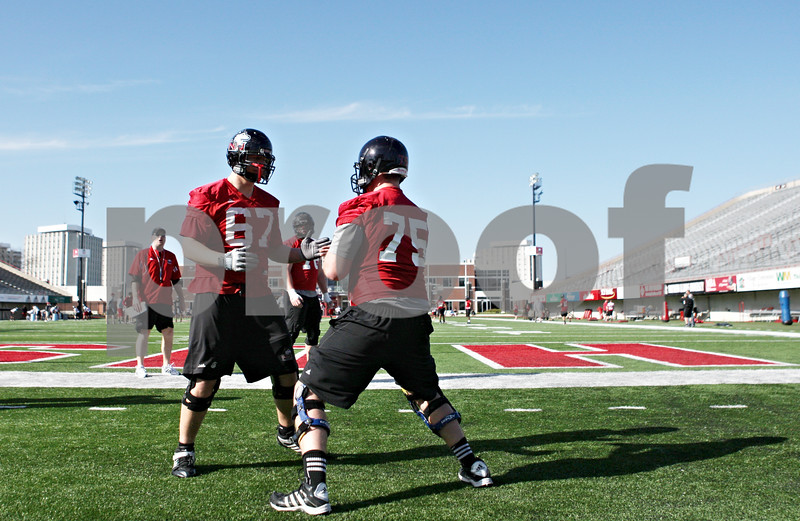 Rob Winner – rwinner@shawmedia.com<br /> <br /> Tyler Pitt (67) and Tyler Loos (75) of the offensive line work on a drill during the first spring practice of the Northern Illinois football team Wednesday.