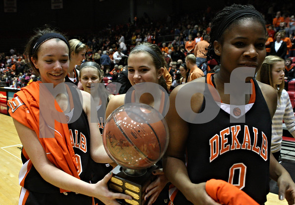 Rob Winner – rwinner@shawmedia.com<br /> <br /> DeKalb's Taylor White (from left to right), Alli Smith and Janay Wright leave the court with their trophy after defeating Sycamore, 39-37, on Friday night at the Convocation Center in DeKalb.
