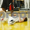 Rob Winner – rwinner@shawmedia.com<br /> <br /> Kaneland guard Dan Miller lays on the floor after a foul in the first quarter of a Class 3A Sycamore Sectional semifinal on Tuesday, March 6, 2012.
