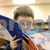 Kyle Bursaw – kbursaw@shawmedia.com<br /> <br /> Erik Castro, 7, reads a spanish-language children's book aloud in the Founders Elementary library during an evening activity at the school on Friday, Feb. 3, 2012.