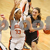 Rob Winner – rwinner@shawmedia.com<br /> <br /> DeKalb's Courtney Patrick (33) defends against Huntley's Haley Ream (right) as Ream drives to the basket in the third quarter during the Class 4A DeKalb Regional final on Thursday, Feb. 16, 2012. DeKalb defeated Huntley, 55-40.