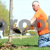 Kyle Bursaw – kbursaw@shawmedia.com<br /> <br /> Gary Knutson, of Knutson Lawncare and Home Services, takes the sod off a freshly transplanted tree before adding some mulch and watering it in its new location around the soccer fields at Huntley Middle School in DeKalb, Ill. on Wednesday, April 4, 2012.