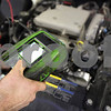 Kyle Bursaw – kbursaw@shawmedia.com<br /> <br /> Motor Works Technician Joe Moberg tests the battery of a Chevy Impala, one of the routine inspections accompanying an oil change on Wednesday, Jan. 4, 2012.