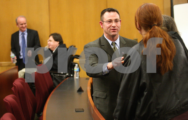 Kyle Bursaw – kbursaw@shawmedia.com<br /> <br /> DeKalb County State's Attorney candidates Sean Smith (foreground) and (standing in background) Clay Campbell speak to attendees after their debate in Swen Parson Hall at Northern Illinois University on Tuesday, March 6, 2012.