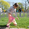 Rob Winner – rwinner@shawmedia.com<br /> <br /> Malerie Gittleson, 6 of Sycamore, collects plastic eggs filled with treats as an Easter egg hunt gets underway at Huntley Park hosted by the First Baptist Church of DeKalb Saturday.
