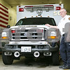 Rob Winner – rwinner@shawmedia.com<br /> <br /> Chief Trent Moser stands next to one of two ambulances at the Cortland Fire Department on Friday afternoon. The town formerly contracted with the city of DeKalb for its ambulance service, but officials decided it would be less expensive to operate their own service, which began on December 1, 2010.