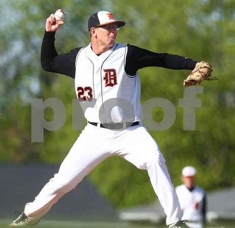 Kyle Bursaw – kbursaw@shawmedia.com<br /> <br /> DeKalb pitcher Corey Nelson tries to pick off a Sycamore runner at first base in the first inning of DeKalb's 6-2 victory over Sycamore at Huntley Middle School on Tuesday, April 10, 2012