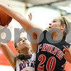 Kyle Bursaw – kbursaw@shawmedia.com<br /> <br /> Indian Creek's Rebecca Goodrich contests a shot by Hinckley-Big Rock's Abbie Tosch in the fourth quarter of their Little Ten Conference Tournament game in Earlville on Monday, Jan. 16, 2012. Hinckley-Big Rock defeated Indian Creek 58-23.