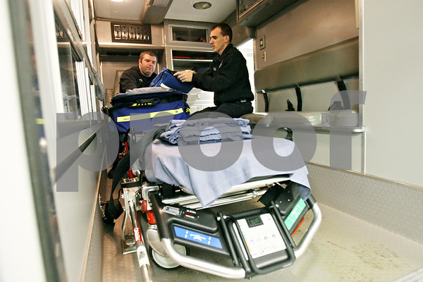 Rob Winner – rwinner@shawmedia.com<br /> <br /> Paramedic Jon Roth (left) and Lt. Mark Hedrick check their supplies in one of the two ambulances at the Cortland Fire Department on Friday afternoon. The town formerly contracted with the city of DeKalb for its ambulance service, but officials decided it would be less expensive to operate their own service, which began on December 1, 2010.