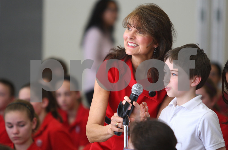 Kyle Bursaw – kbursaw@shawmedia.com<br /> <br /> St. Mary School teacher Carole Liske helps fourth-grader Dmitri Taylor with the microphone as he asks Former U.S. Speaker of the House Dennis Hastert a question on Thursday, March 22, 2012.