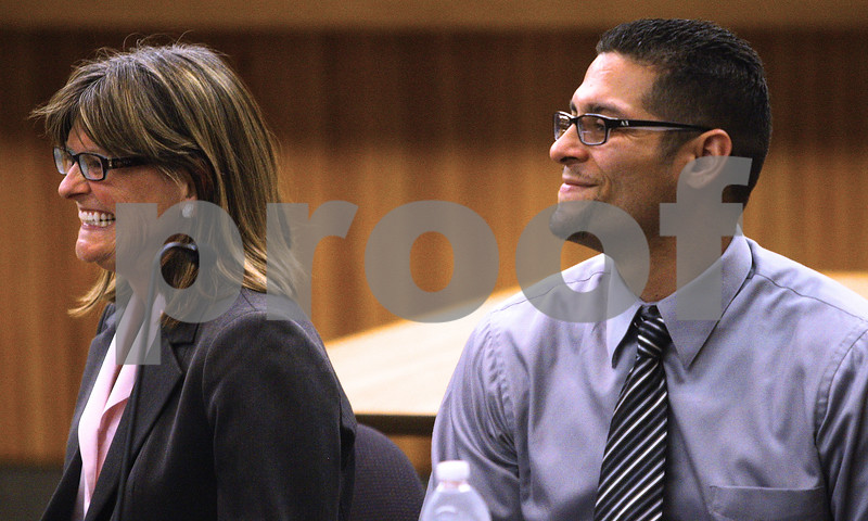 Kyle Bursaw – kbursaw@shawmedia.com<br /> <br /> Jane Raley (left), a senior staff attorney at Northwestern's Center on Wrongful Convictions, and Juan Rivera Jr. smile as they watch a video of Rivera's first moments as a free man after spending nearly 20 years in the Illinois Department of Corrections. The two spoke at the 'Innocence Panel' in Swen Parson Hall at Northern Illinois University on Tuesday, April 3, 2012.