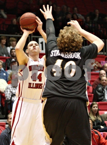 Rob Winner – rwinner@shawmedia.com<br /> <br /> Northern Illinois forward Tyler Storm (444) puts up a field goal over Western Michigan center Matt Stainbrook (40) during the first half in DeKalb on Wednesday, Feb. 15, 2012.