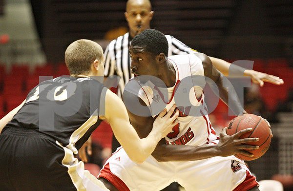 Rob Winner – rwinner@shawmedia.com<br /> <br /> Western Michigan guard Brandon Pokley (10) pressures Northern Illinois guard Antone Christian during the first half in DeKalb on Wednesday, Feb. 15, 2012.