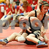 Rob Winner – rwinner@shawmedia.com<br /> <br /> Sycamore's Logan Mathey (front) competes with DeKalb's Jackson Montgomery during the Northern Illinois Big 12 Conference tournament 106-pound quarterfinals in Ottawa on Saturday.