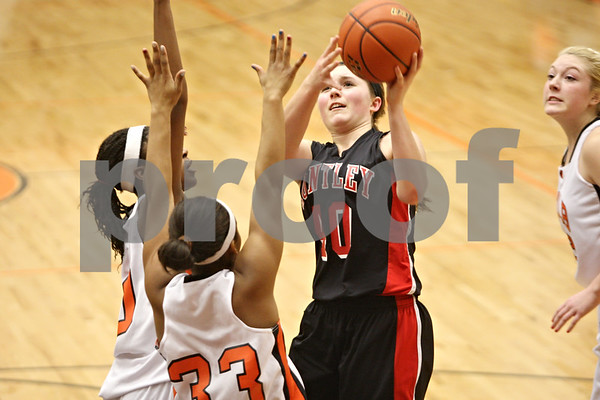 Rob Winner – rwinner@shawmedia.com<br /> <br /> Huntley's Samantha Andrews (40) puts up a shot in the second quarter during the Class 4A DeKalb Regional final on Thursday, Feb. 16, 2012. DeKalb defeated Huntley, 55-40.